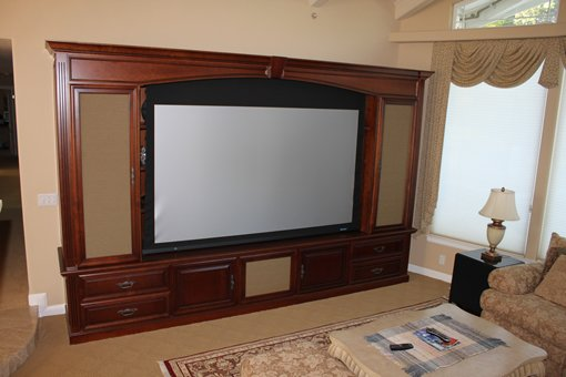 Custom Media Center With Bookshelves U0026 Hidden Retractable Projection Screen.  Beautifully Crafted Cherry Wood Cabinets With A Rich Stain Finish.
